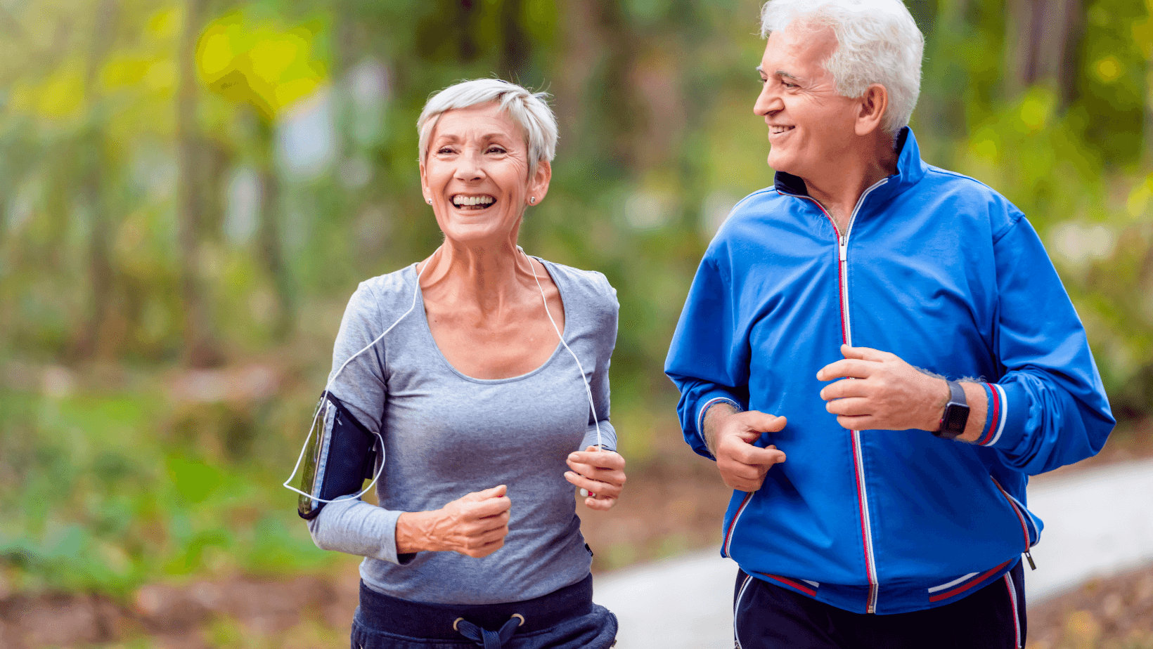 senior woman and man jogging outdoors