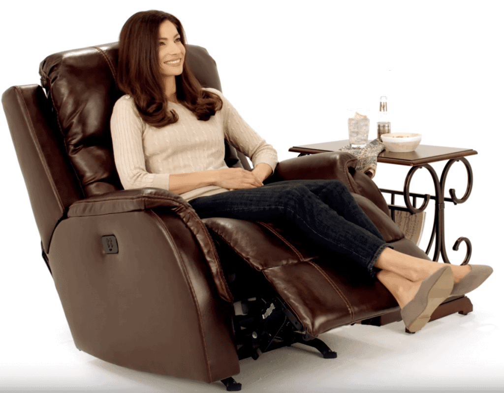 Woman reclining in blrown leather electric lift chair