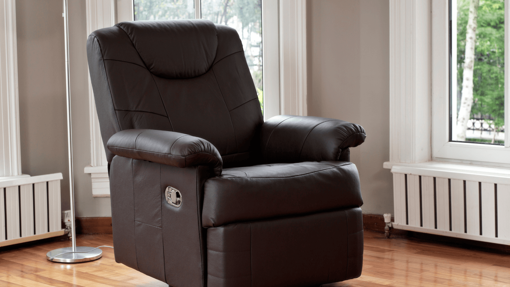 brown leather reclining chair in the corner of a living toom
