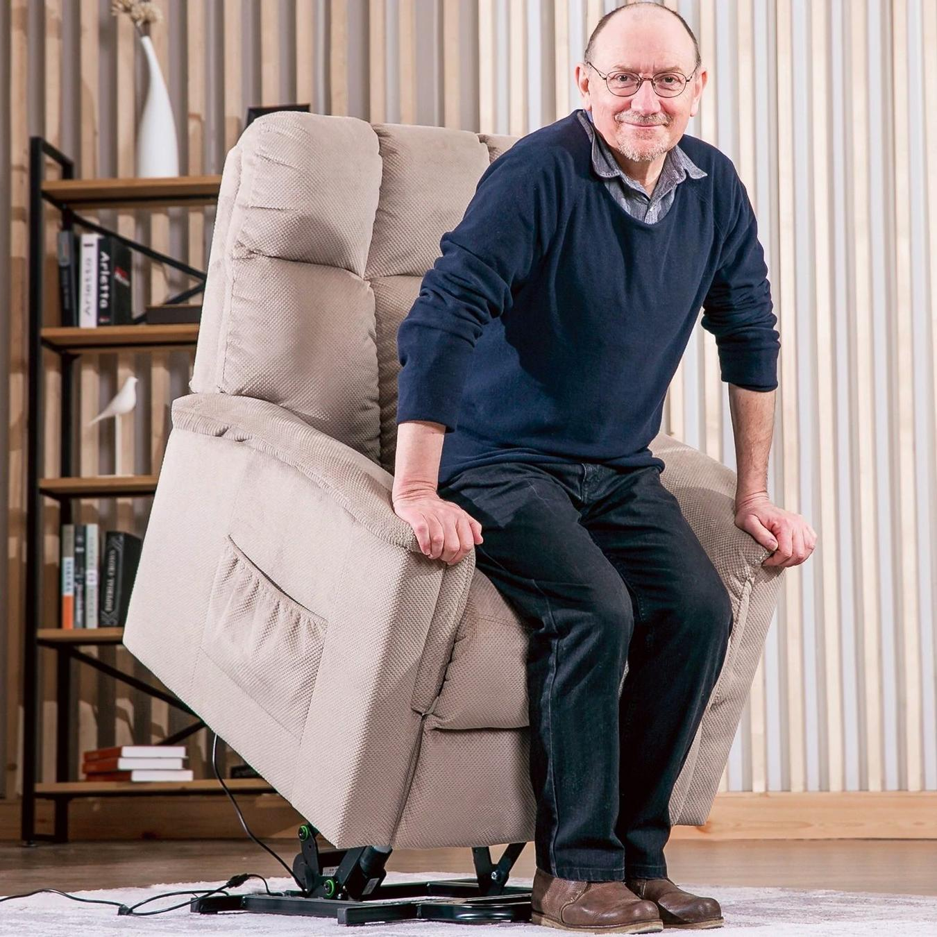 Tan reclining lift chair raising up allowing an older man to stand up out of the chair